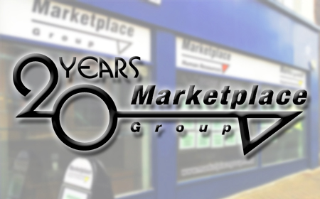 A picture of the offices with a Marketplace 20th Anniversary Logo